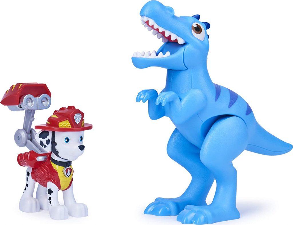 Ce pack comprend la figurine de Marcus de la Pat Patrouille et un dinosaure.